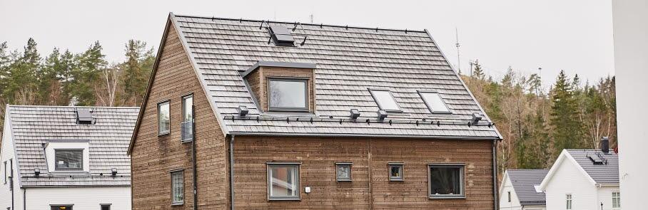 Bostadshus med en takkupa